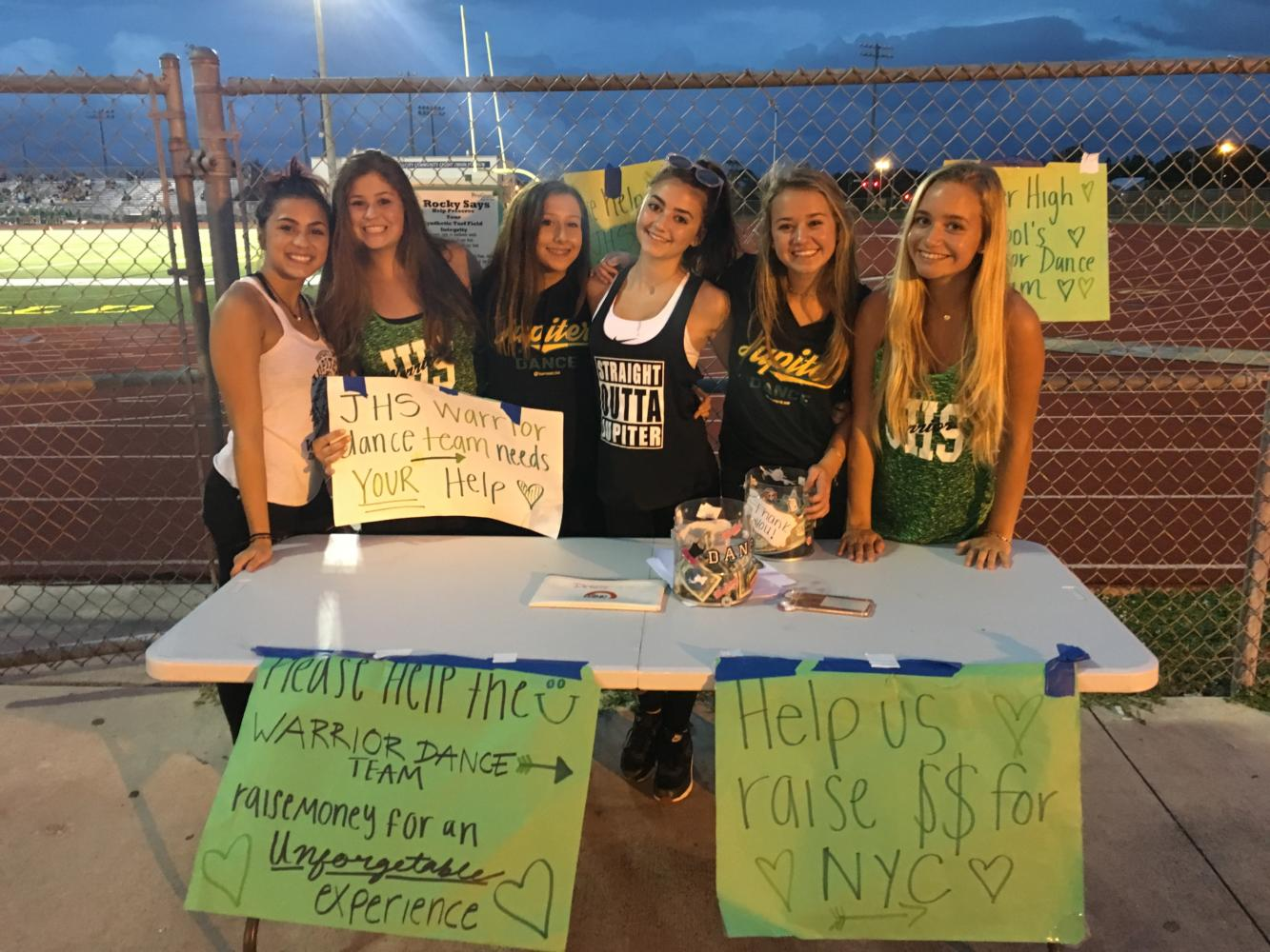 Dance team members help fundraise for their New York trip at a home football game September 1.