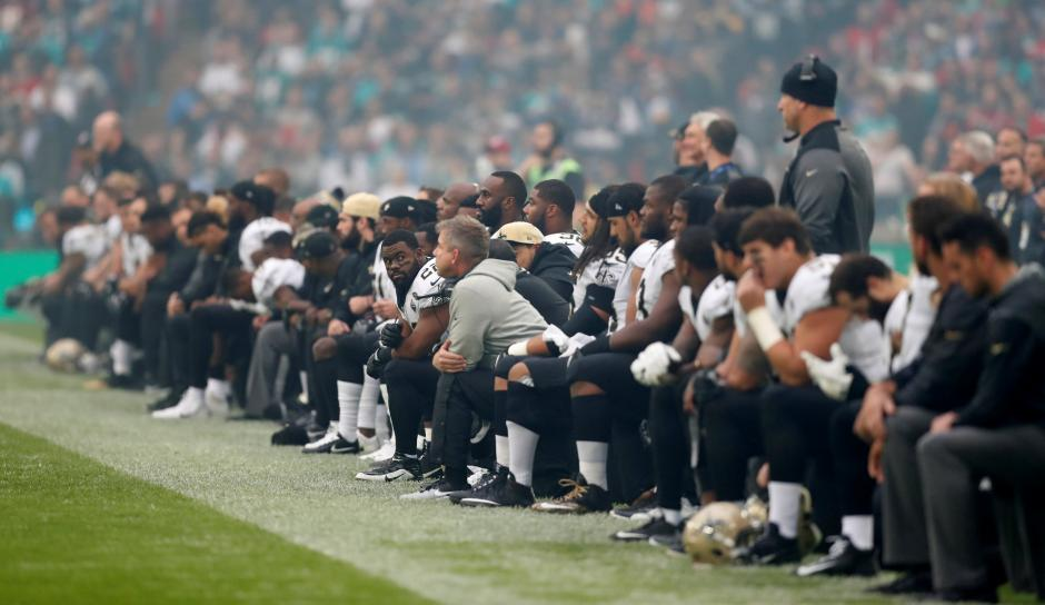 New Orleans Saints players take the knee before the start of the national anthem    Action Images via Reuters/Matthew Childs
