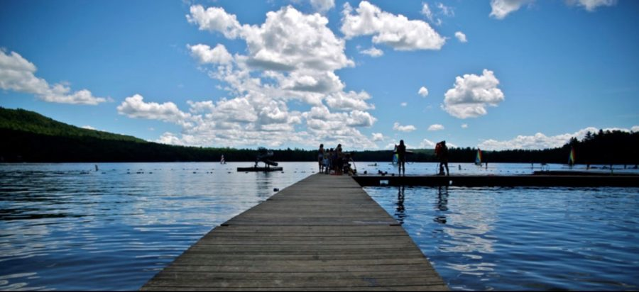 Campers+enjoy+swimming+and+boating+in+Lake+Sebago.+Photo+by+Arden+Yum