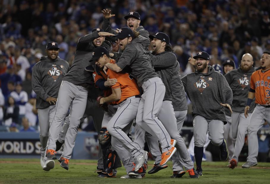 The Houston Astros celebrate after their first ever World Series championship title