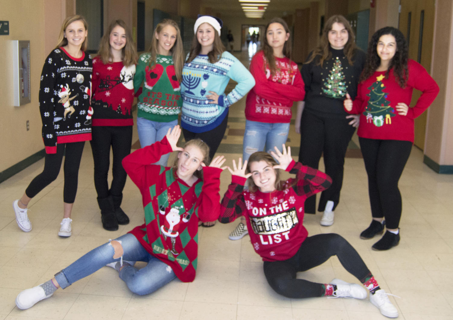 Jupiter War Cry staff shows off their festive holiday sweaters.