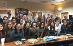 SGA staff and Jupiter police group together after decorating the police station for the holidays. Photo by. Jeanmarie McCann, the SGA teacher