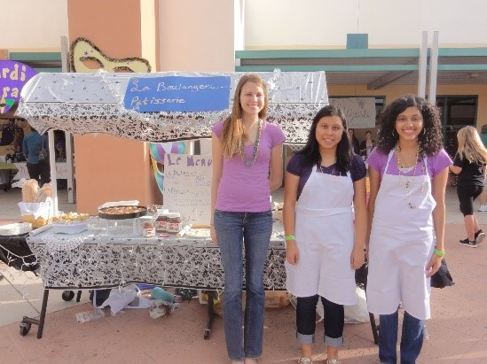 Former French III students patisserie booth at Mardi Gras.