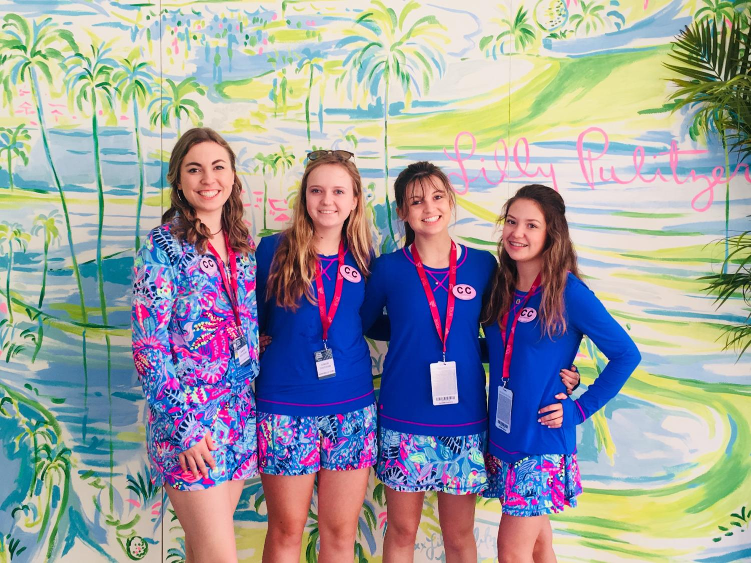 Junior Couture club members juniors Katelyn Smallwood and Lexi Coquillette and sophomores Annabelle Ford and Cressa Bronson pose in front of a Lilly Pulitzer-themed wall at the Honda Classic, a fashion company which sponsors both the Couture Club as well as the Honda Classic.