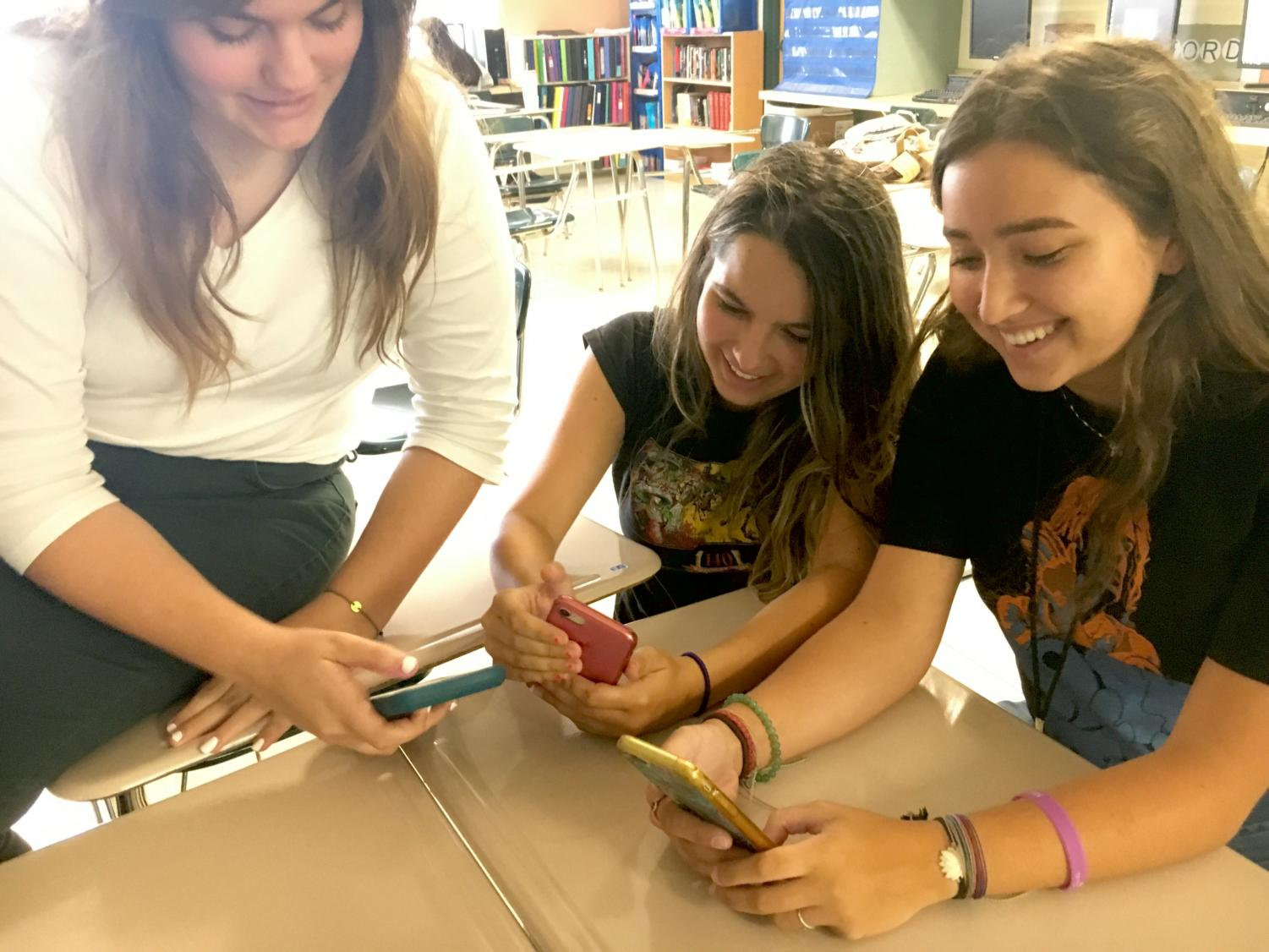 (From left to right) Seniors Adriana Beltrano, Larissa Holloway and Lilly Grella staying on top of their school game by downloading academic apps.