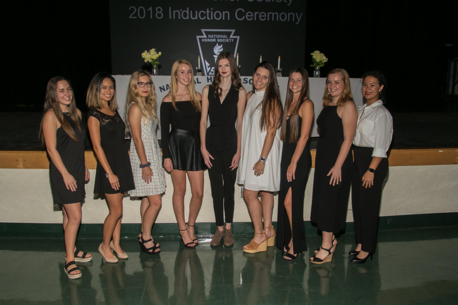 (From left to right) National Honor Society officers Elisabeth Stahl, Gabi Young, Lily Greever, Rachel Caspar, Gabrielle Summers, Elyssa Belcastro, Shannon Sawtell, Ashley Sepulveres and Chris Palles at the induction ceremony.