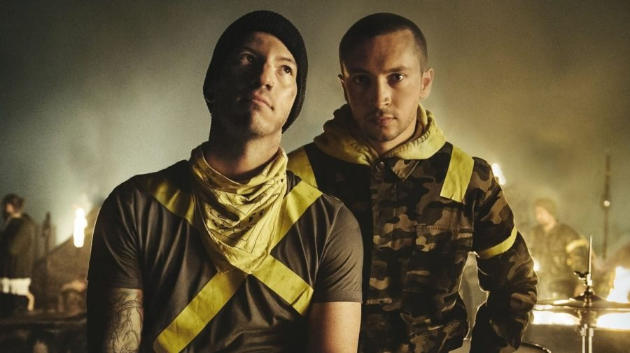 Josh+Dun+%28left%29+and+Tyler+Joseph+%28right%29+pose+decked+out+in+yellow+tape%2C+representing+their+%E2%80%9CTrench%E2%80%9D+era.