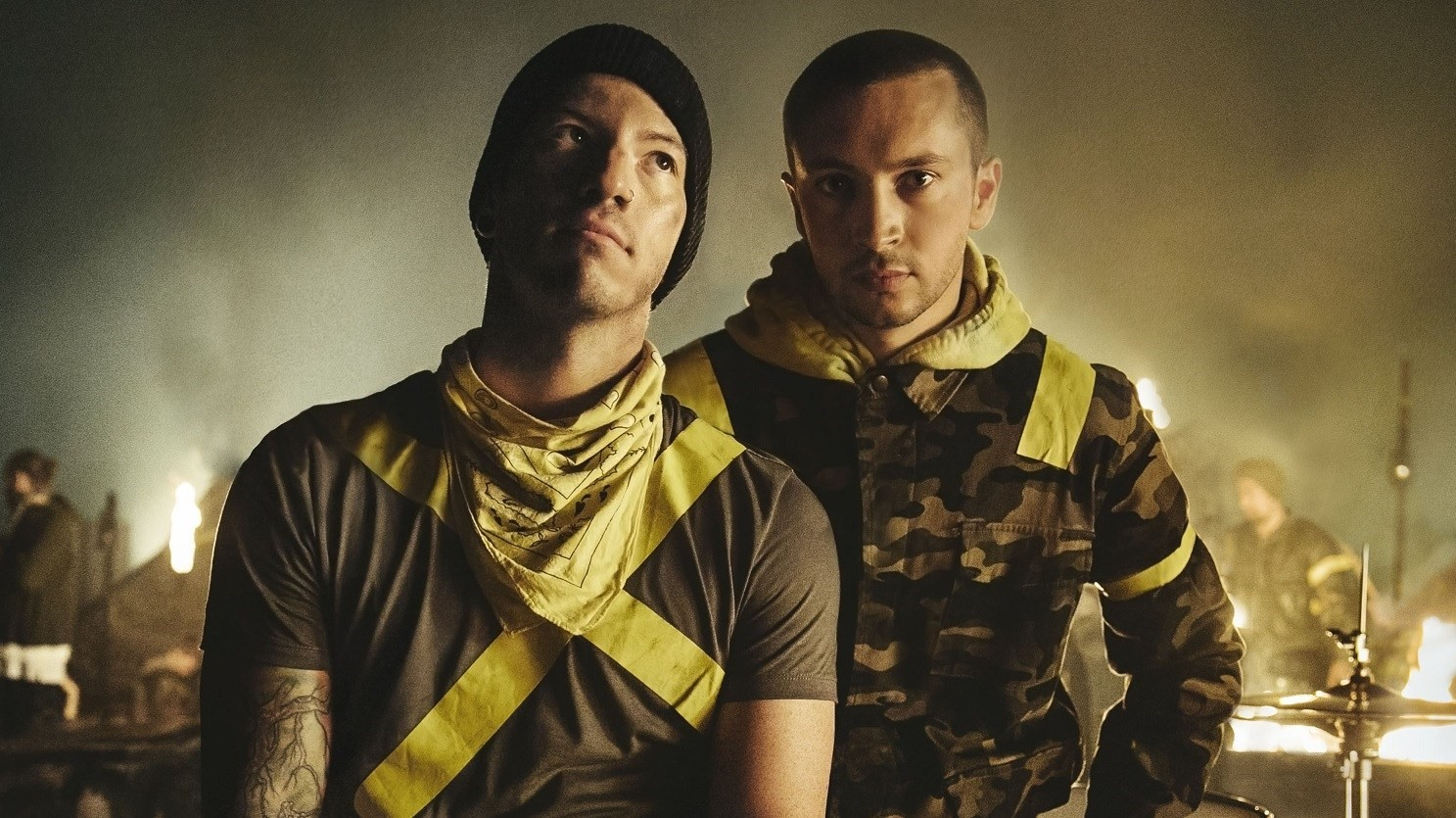 "Josh Dun (left) and Tyler Joseph (right) pose decked out in yellow tape, representing their ""Trench"" era."