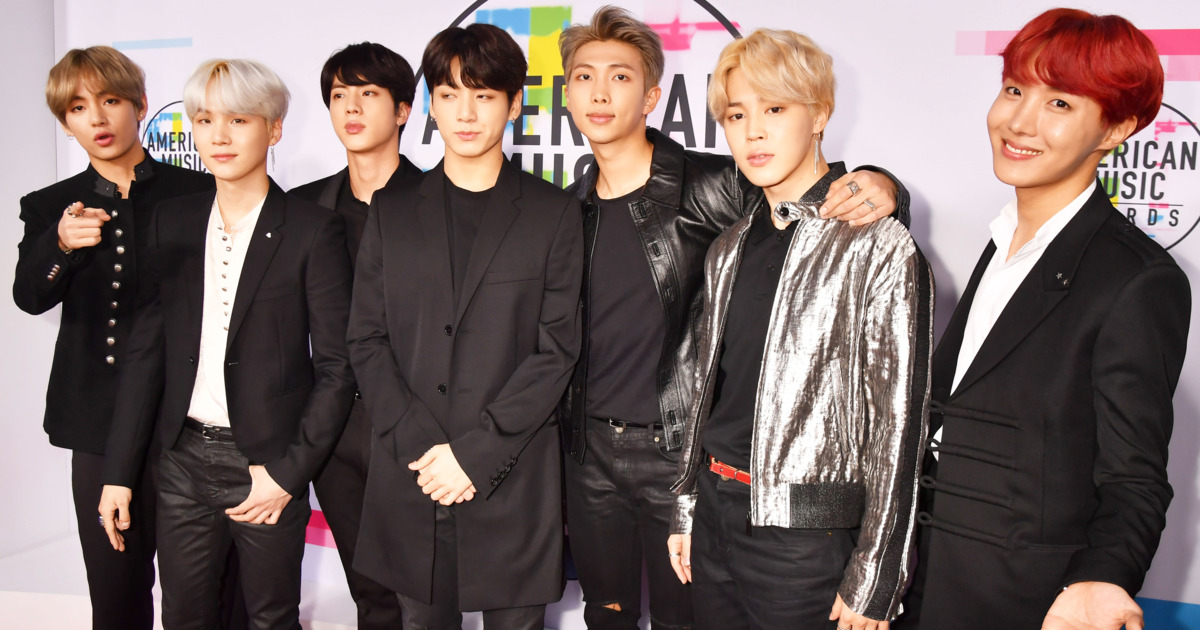 Caption: Members of International K-Pop group BTS (left to right) V, Suga, Jin, Jungkook, RM, Jimin and J-Hope have renewed their contract for another seven years.
