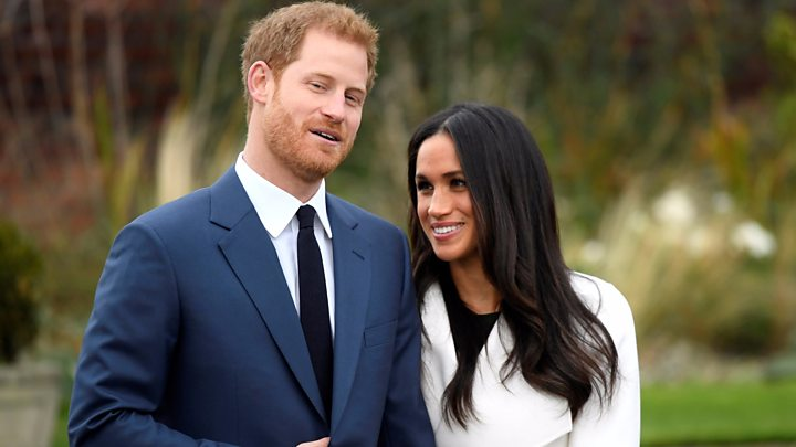 Meghan+Markle+and+Prince+Harry+smiling+about+their+first+upcoming+child.