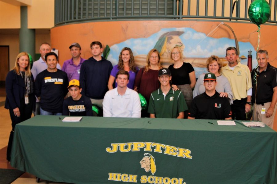 Senior+signees+%28left+to+right%29%3A+David+Colton%2C+Gavin+Scott%2C+Charles+Fishbaugh%2C+Jake+Garland+gathered+in+the+atrium+with+their+families+and+coaches+to+sign+their+National+Letters+of+Intent.+