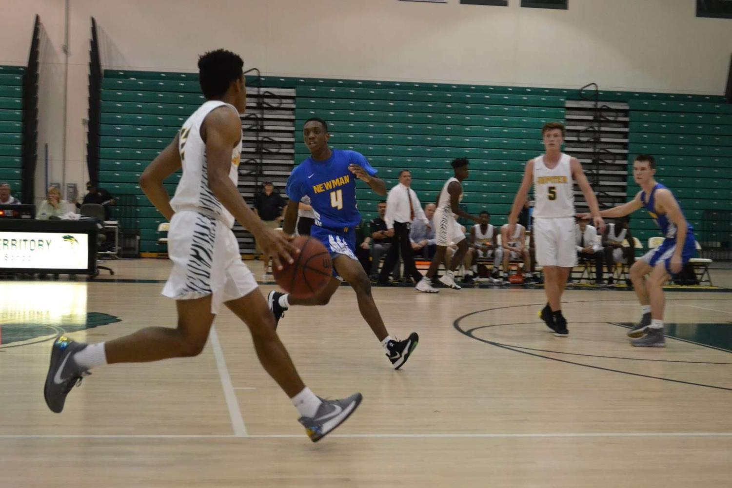 Junior Jaquel Stroman (left) and senior Trent Webb (right) playing in the first game of the season.