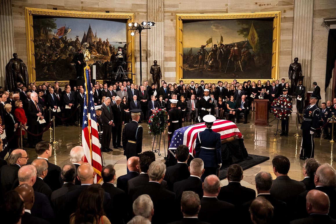 George H.W. Bush lies in state at the U.S. Capitol.