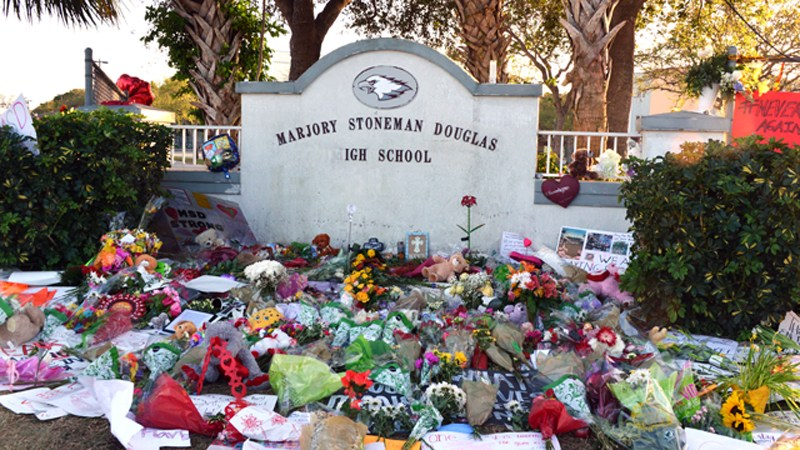 Flowers and posters pay tribute to victims of Marjory Stoneman Douglas High School.