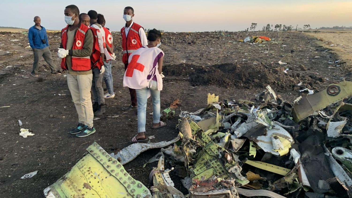 Rescuers in Ethiopia helping with the Ethiopian Airlines wreckage.