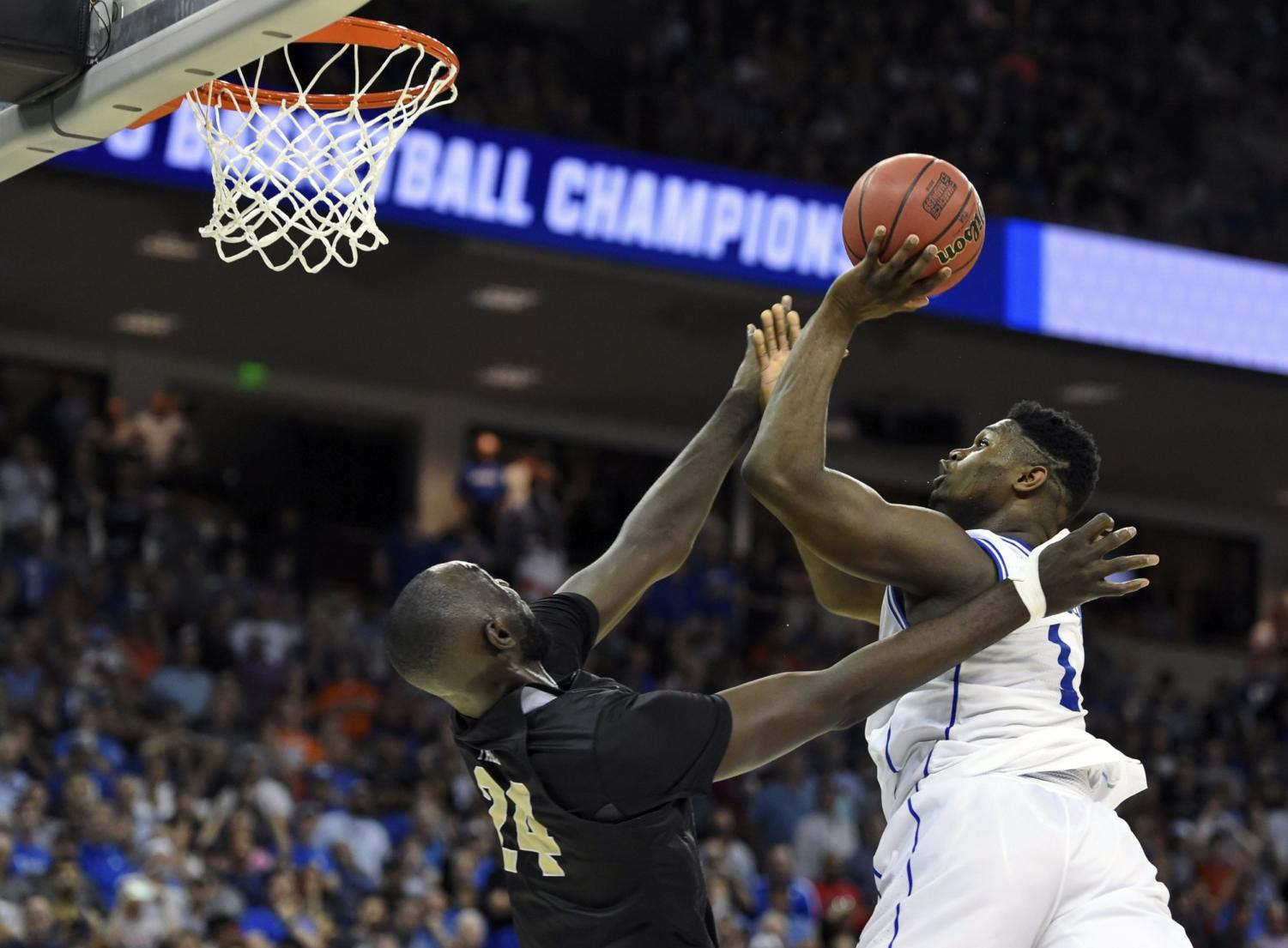 Duke's Zion Williamson  and UCF's Tacko Fall battle it out in an epic March Madness game.