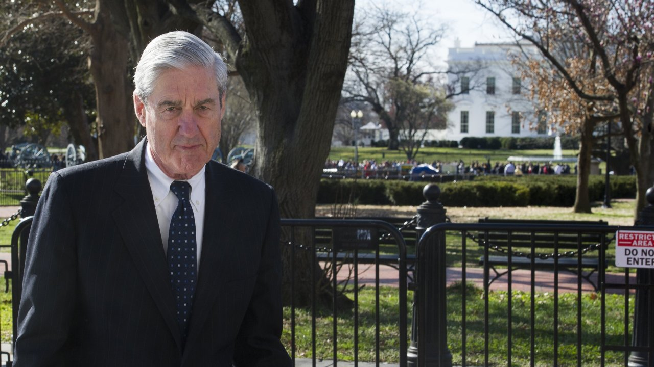 Special Counsel Robert Mueller walks past the White House.
