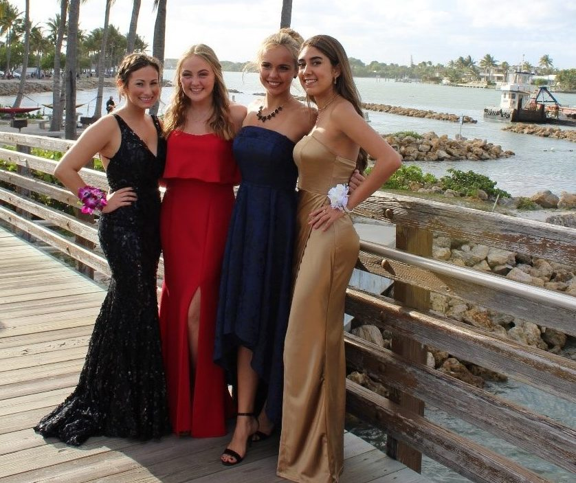 Samantha Clayman, Emily Fritz, Kayden Layman and Jessica Jaramillo in their prom dresses taking photos at Dubois park.