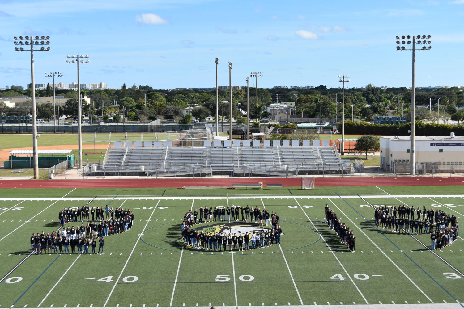 Seniors stand in the shape of their graduating year on the Jupiter High turf field on Dec. 19.