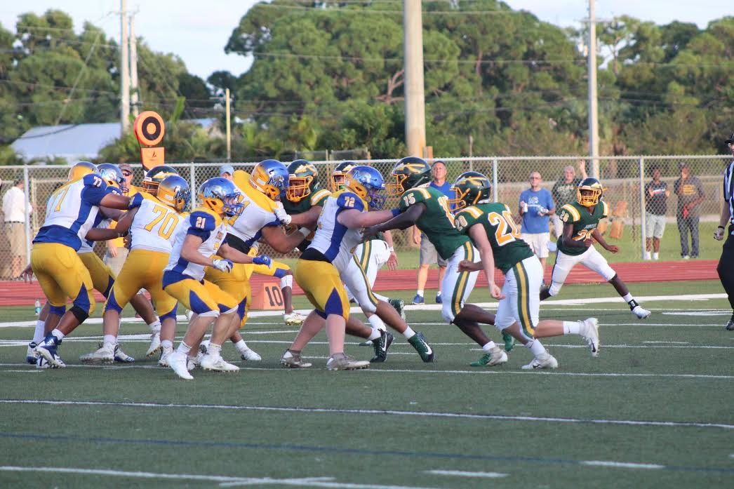 Football players from both Jupiter High School and Martin County High School on Sept. 9