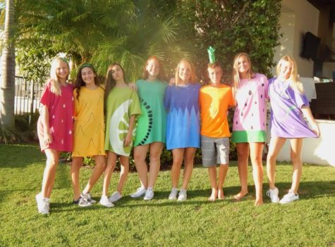 "Juniors Nicki Christe, Valentina Sarabia, Sophia Gonzales, Coraleigh Clacaterra, Anna Spicer, Anna Spivey, Carly Green and sophomore Will Dugan posing in their fruit ""Do It Yourself"" costumes in 2017"