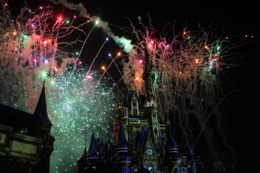 The+Cinderella+Castle+in+Disney%27s+Magic+Kingdom%2C+with+fireworks+from+the+nightly+show+in+the+background.+