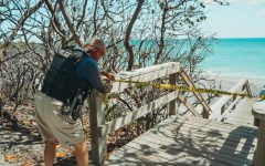 Jupiter police officer tapes off  one of many walkways to Jupiter Beach that is closed due to coronavirus (1 April)