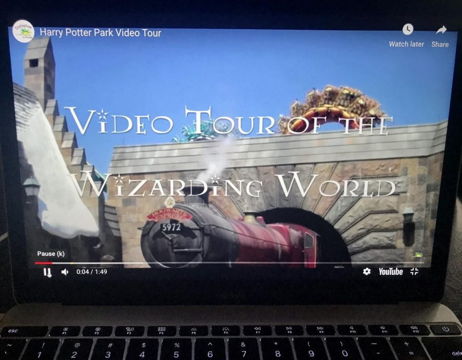 Video tour of the Wizarding World of Harry Potter as seen on a laptop.