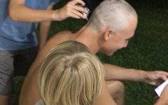 Scott Meissner's family shaves his head in preparation for military boot camp.