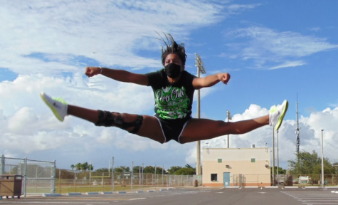 Jupiter High varsity cheerleader Bianca Stribling participates in  daily conditioning for the sideline cheer team.