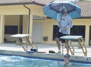 Swim-and-dive coach returns to Jupiter