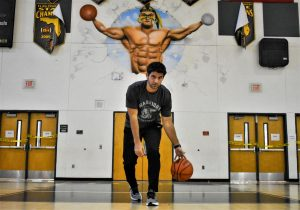 New Jupiter basketball coach, Joseph Depasquale, practices his skills during his planning period in the Jupiter gym.