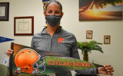 Assistant Principal Kelly Foss proudly displays her Cleveland Browns pennant, shirt and watch band on Jan. 11 after the Browns defeated the Steelers on Jan. 10.