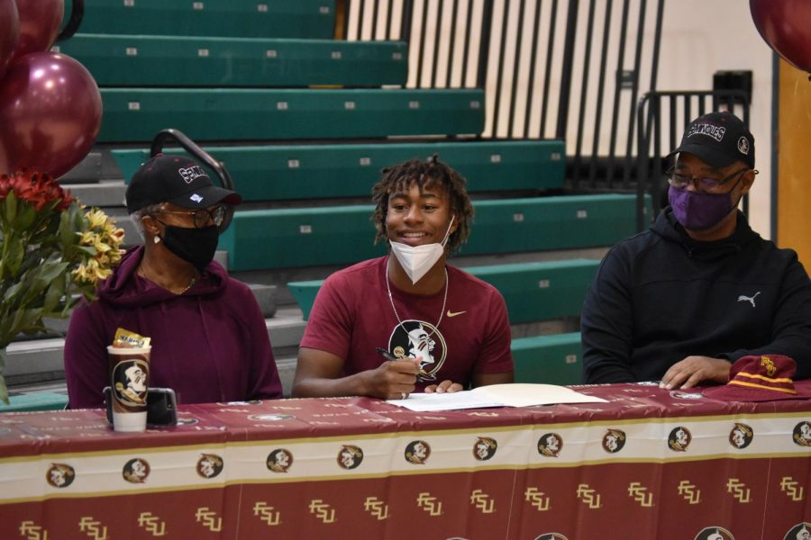 Jupiter athletes sign for their futures