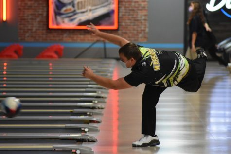 Ethan Espenship, senior, bowls a strike at Bowlero in Jupiter during a Nov. 11 match.