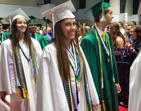 Alicia Gustafson walks with her fellow 2019 graduates at the Palm Beach County Convention Center.