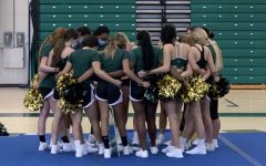 Jupiter High cheer team huddles for a quick break during practice.