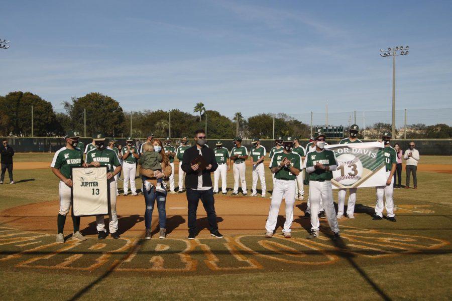 Taylor Davis's jersey retired in ceremony at Doug Ferguson Field.