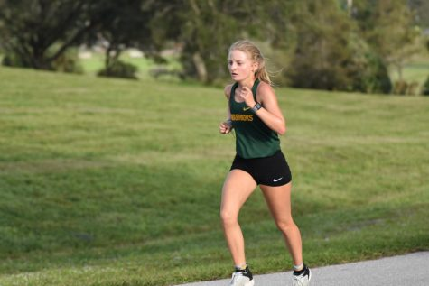 Senior Sydney Buck competing in a cross country meet.
