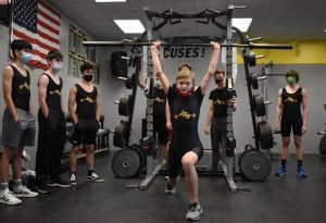 Boys weightlifting competes at regionals
