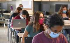 Students wear masks in the classroom for safety precautions.