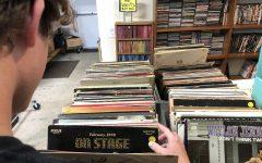 Teenager looks through vintage vinyl records