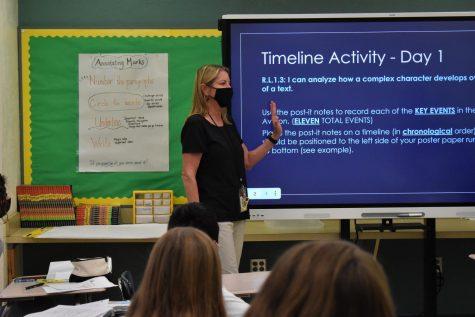 Jill Plummer captured teaching her students.